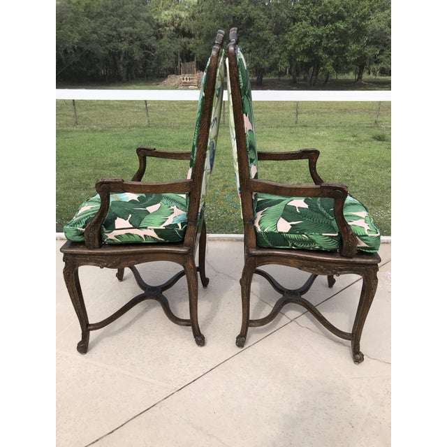 Birds in Paradise Coastal Regency French Carved custom upholstered in tropical palm and Parrot fabric arm chairs. I love...