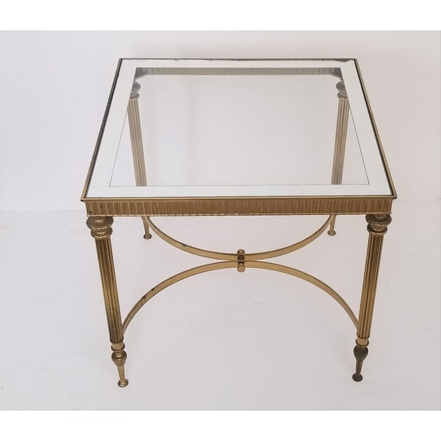Offering a vintage Mid Century solid brass side table with a mirrored edge glass top made in Italy, circa 1960s. This...