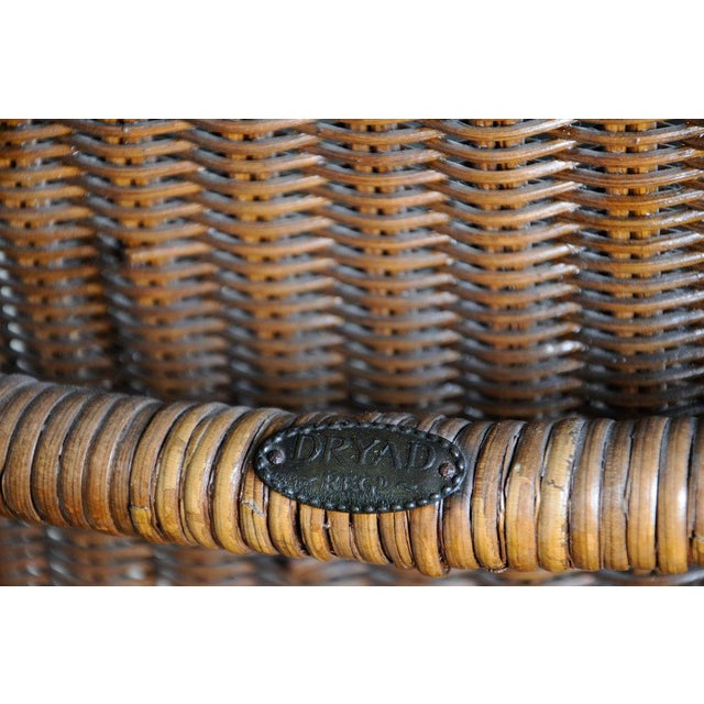 Early 20th century wicker chaise by Harry Peach Company, Leicester, England. Drayad registered. Original logo designed by...