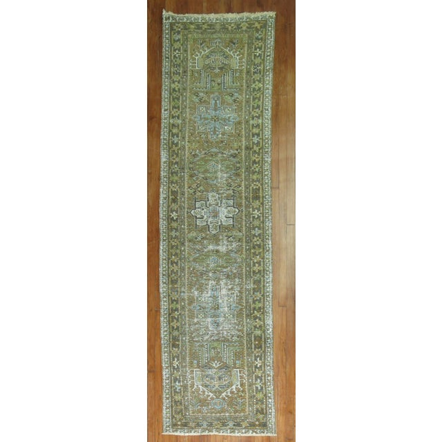 Persian Heriz Runner in predominant brown, accents in green and blue. Perfectly worn giving it a super patina and texture....