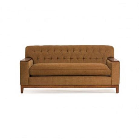 O. Henry House sofa with tufted back and brown faux suede fabric, beautiful exposed wood arms and base in an Old World...