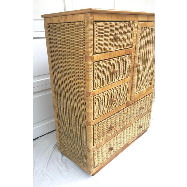 A beautiful wardrobe/dresser in natural rattan with solid wood knobs. There are five total drawers and a side cabinet with...