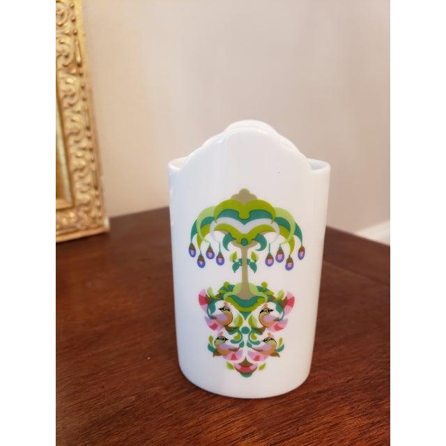 Petite vase with colorful design.