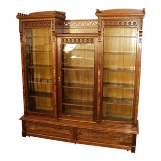 20th Century Victorian Walnut Eastlake 3-Door Library Bookcase For Sale