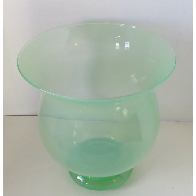 Large soft spring green blown glass urn-shaped footed vase in the style of Steuben. There is a slight milky quality to the...
