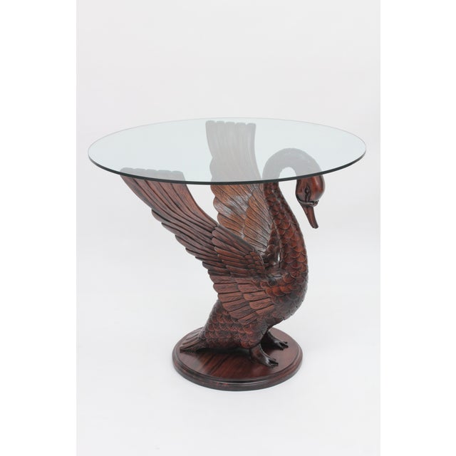 Beautifully carved swan table made of solid Mahogany wood.