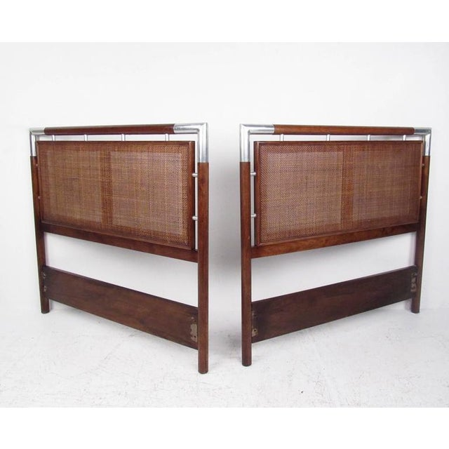 This vintage modern pair of headboards features a unique Mid-Century design with woven cane and chrome details. Can be...