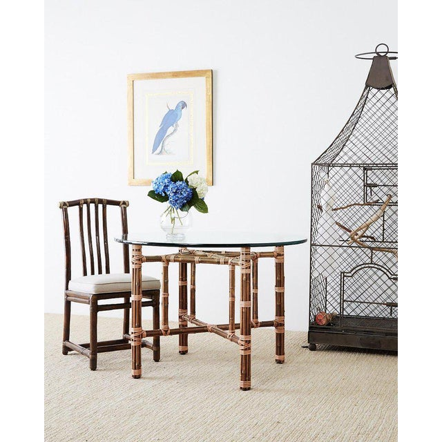 Genuine McGuire organic modern style round dining table constructed from an iron frame wrapped with bamboo rattan....