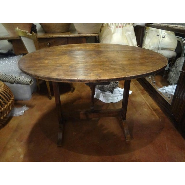 Offered is a 19th century French round walnut wine tasting table from the Burgundy Region of France. Our French wine table...