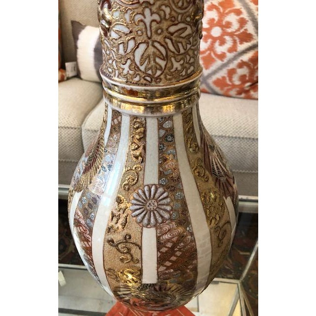 A stunning vase, over 100 years old! Tall and lean with a beautiful long neck, this vase is a show stopper. Accents in 24k...