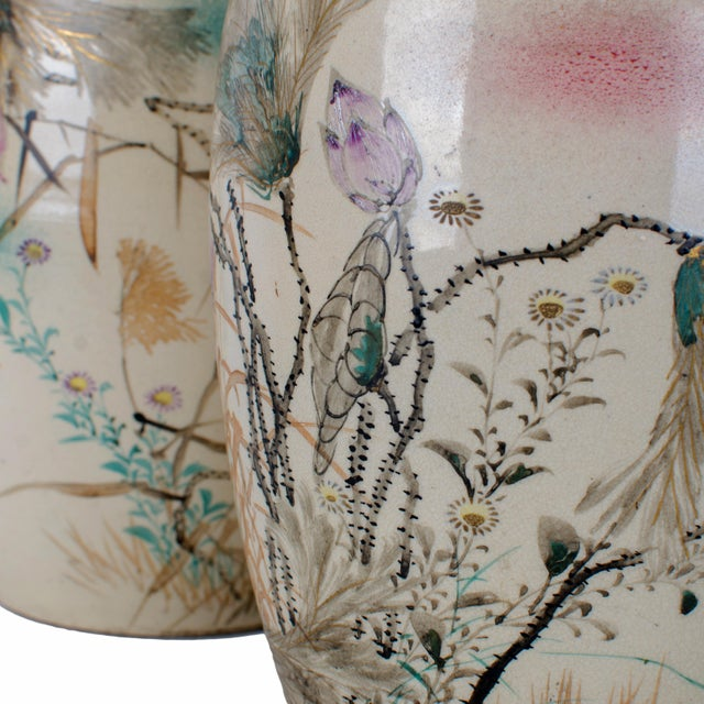 A pair of antique hand painted and signed Japanese vases. Gold signature is worn. Some wear to paint, crazing and hairline...
