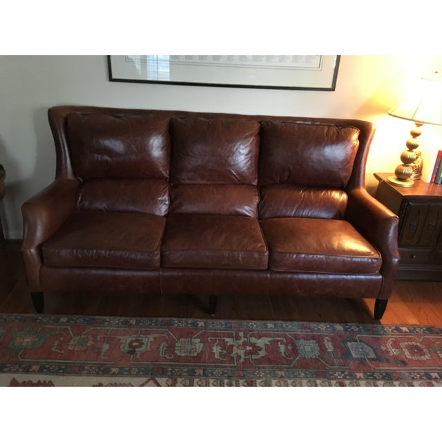 Leather Alex sofa from Arhaus in rich harness brown. Light surface scratching consistent with moderate use. This sofa is...