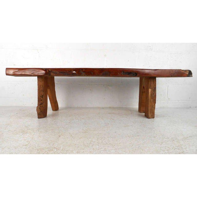 This long free edge wood slab coffee table features natural wood grain under a vintage clear coat finish. Sturdy and...