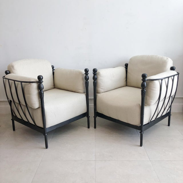 Impressive pair of lounge patio chairs designed by Michael Taylor. From Taylor's Montecito collection. Each seat and back...