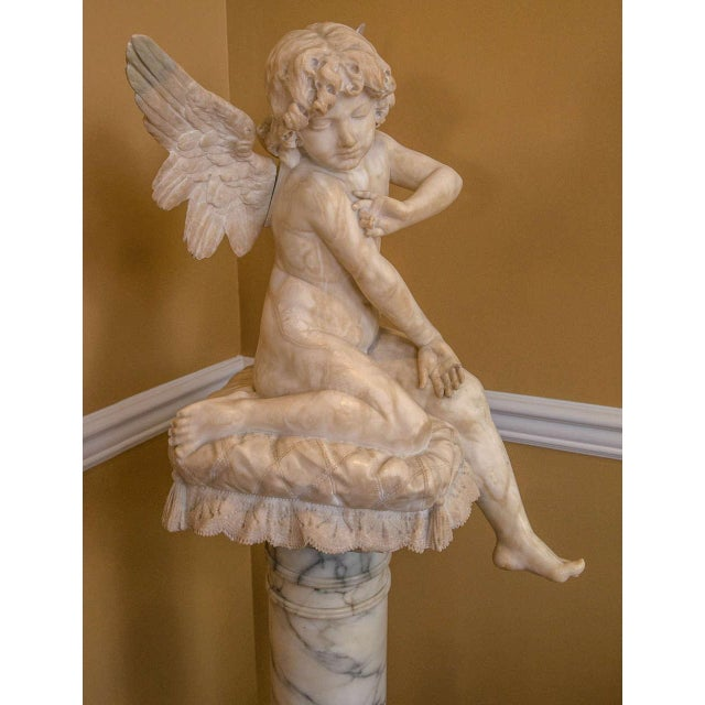 Alabaster Figure Winged Angel Sitting on a Pillow on an Alabaster Pedestal For Sale In New York - Image 6 of 9