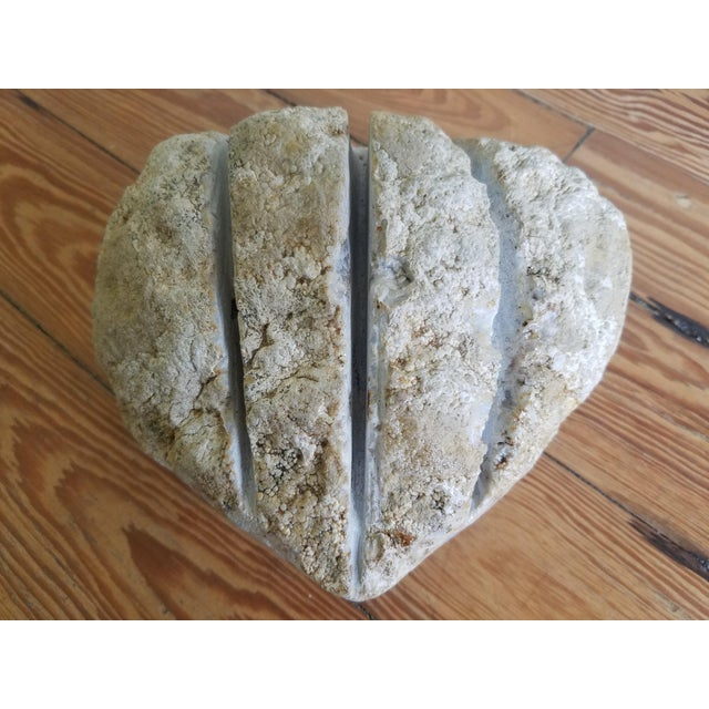 Market found, I love the earthy organic nature of this carved heart shaped marble decorative object. No signature.
