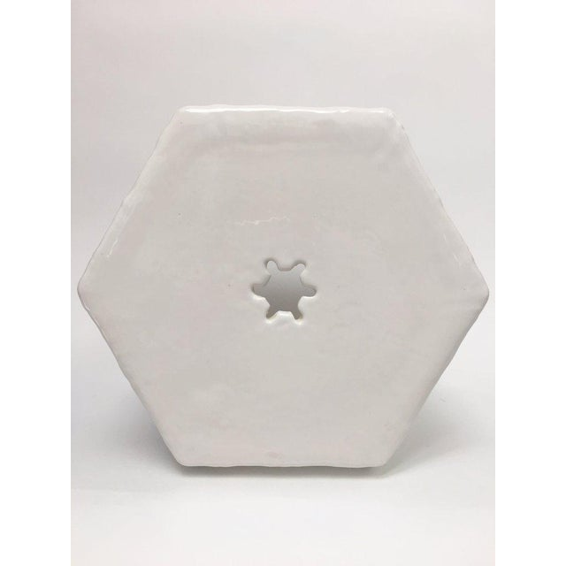 Blanc de chine ceramic garden stool made in Italy for Paul Hanson. It features a hexagonal shape, raised bamboo motif...