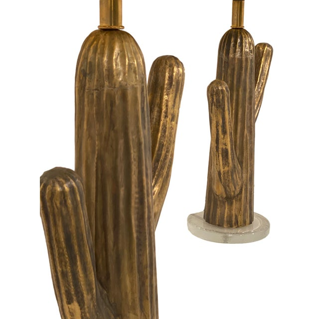 Pair of vintage Italian brass cactus lamps. Each features a brass cactus planted mounted on a clear glass base. We love...
