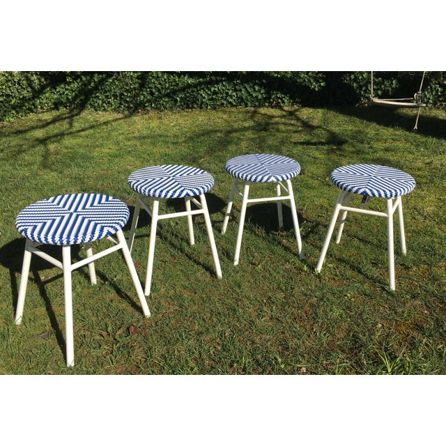 In great shape, purchased about a year ago and stored inside, never used. Price is for all four stools. Blue & white...