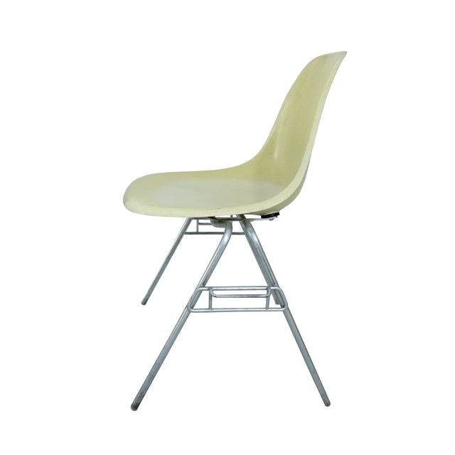 Iconic Charles Eames designed fiberglass chairs from the 1960s. This early fiberglass Eames shell side chair with stacking...
