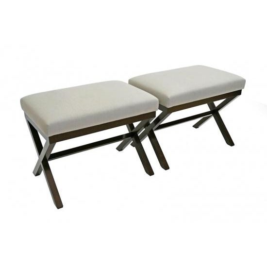 BK Limited edition pair of walnut X-form benches with upholstered muslin seats (Shown COM). Custom sizing available....