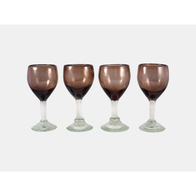 Boho chic wine glasses in an earthy mauve color. Each wine glass is hand-blown and will therefore have slight...