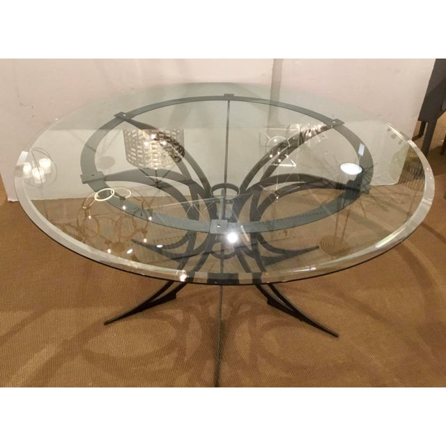 Original retail $5000, Global Views modern iron and glass revolution dining table, beveled top, showroom floor sample
