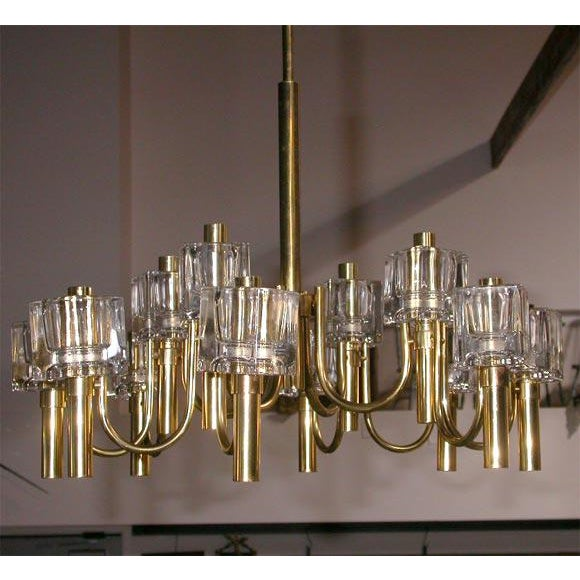 This is a twelve light fixture having four arms, each with three lights. Each light has a most substantial 2 3/4 x 3 1/4ht...