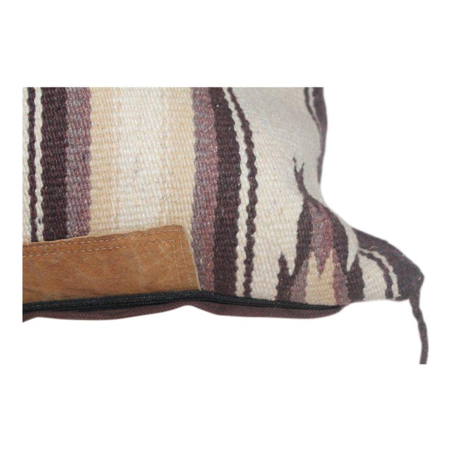 This Indian saddle blanket weaving has the original leather trim on both sides of the weaving. The condition is very good...