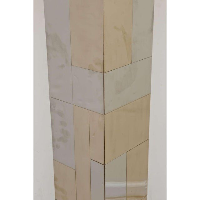 The patchwork or random tile patterning of the mixed metals of chrome-plated and brass-plated cityscape Paul Evans floor...