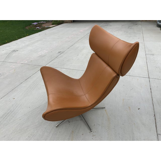 Beautiful Imola Chair with swivel function and matching ottoman from BoConcept. Legs in brushed steel with caramel oxford...