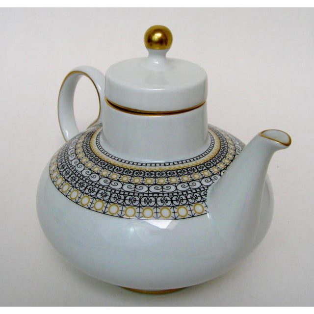 White-glazed teapot by Verbano Industria Argentino, with a Moorish-inspired band in marigold and very dark brown/nearly...
