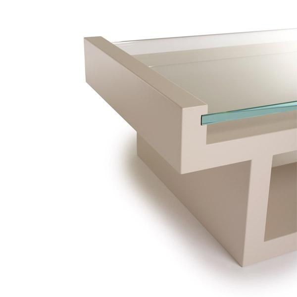 The stunning Hinge Table is a harmonious balance between its sleek sophisticated glass top and the strong lacquered base...