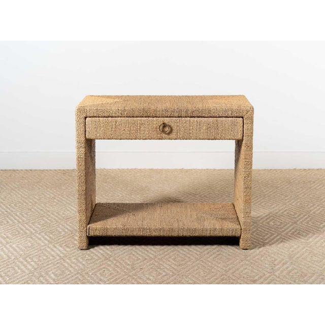 Short side table Single drawer with brass pull ring Bottom shelf Woven rope construction in natural finish