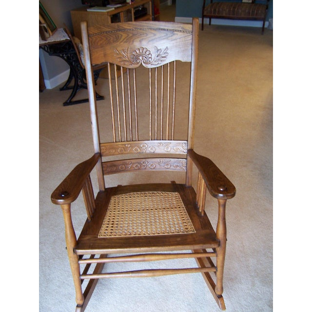 Purchased years ago at an estate auction. Caned set and three pressed back designs. It is a beautiful chair estimated to...