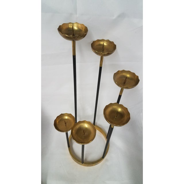 Mid-Century Brass Candle Stick Holder This is a beautiful piece of 6 graduated brass candle holders all connected at the...