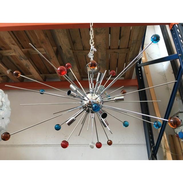 Chandelier murano glass triedo sputnik multicolored chandelier. Metal frame in color kromo. Chandelier has different rods...