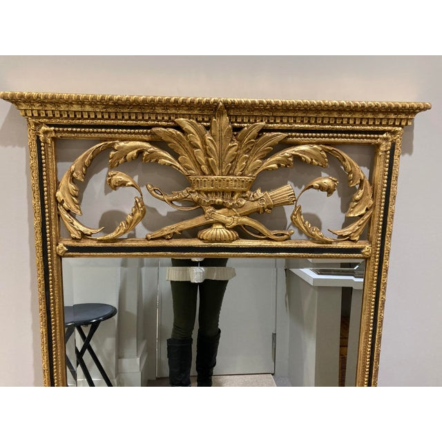 Beautiful vintage mirror made by Decorative Arts, INC. in Miami, Florida. Features gold and black paint and ornate...