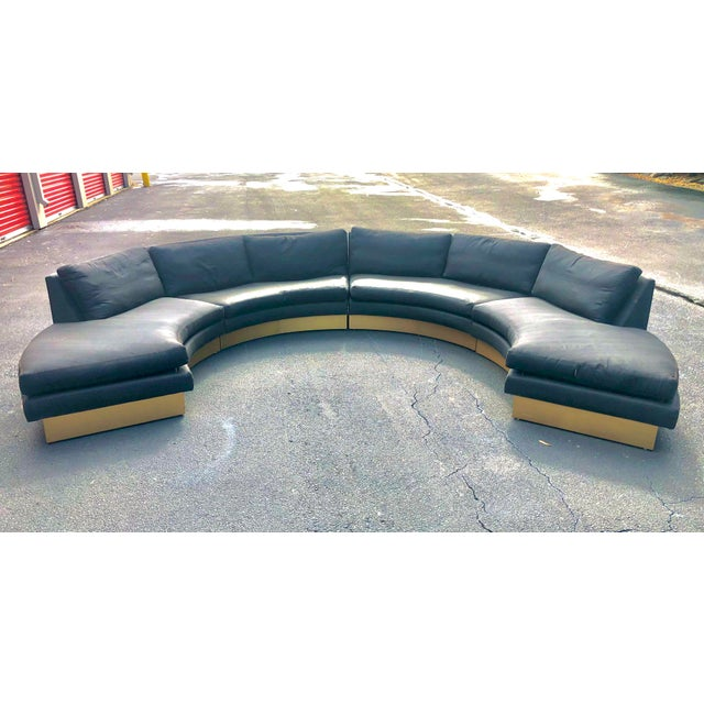 Beautiful circular sofa ready for new upholstery. Very sturdy construction and sits on a solid wood base with faux brass...