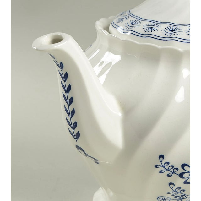 Johnson Brothers Blue Nordic Teapot & Lid features the classic blue onion design. It is the perfect complimentary tea...