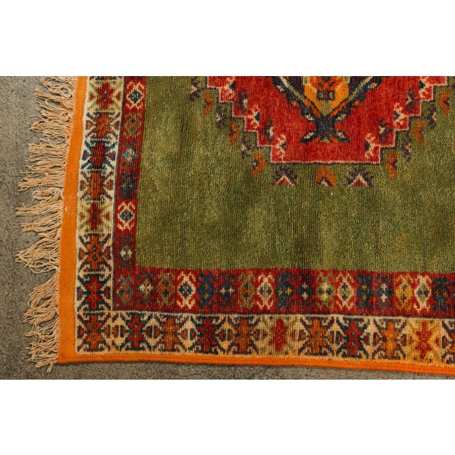 Handwoven by Berber women in Morocco using organic wool. This rug symbolize spring with the green field and geometrical...