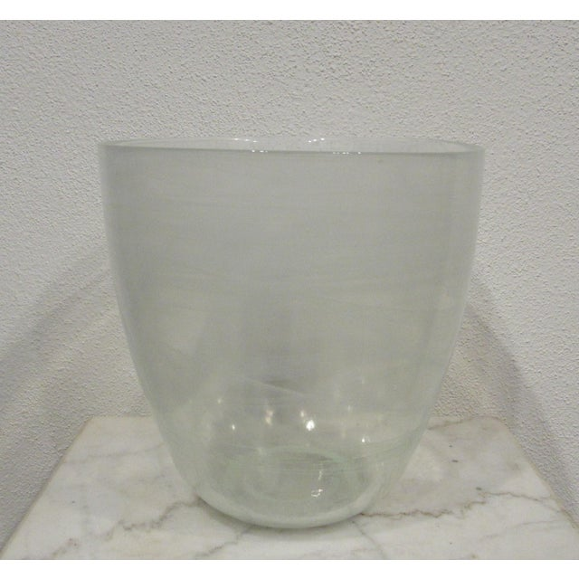 This is in excellent condition and perfect for any dinner party. It is clear with white variations in it.