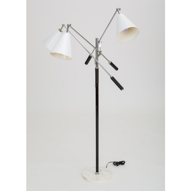 An Italian modernist lamp from the 1950s. The tall floor lamp was a round base in carrara marble, a central steel post...