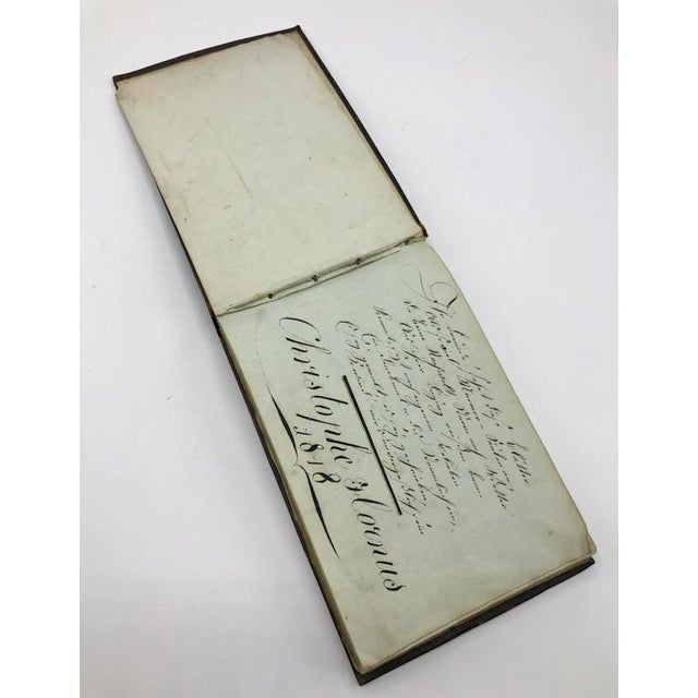Parlez vous francais? This is a personal antique French leather journal dated 1818 owned by Christophe Hornus. It has his...
