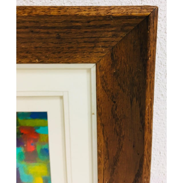 This is the 20th century acrylic on paper painting on paper. Framed in a vintage solid oak. Triple matted with cream...