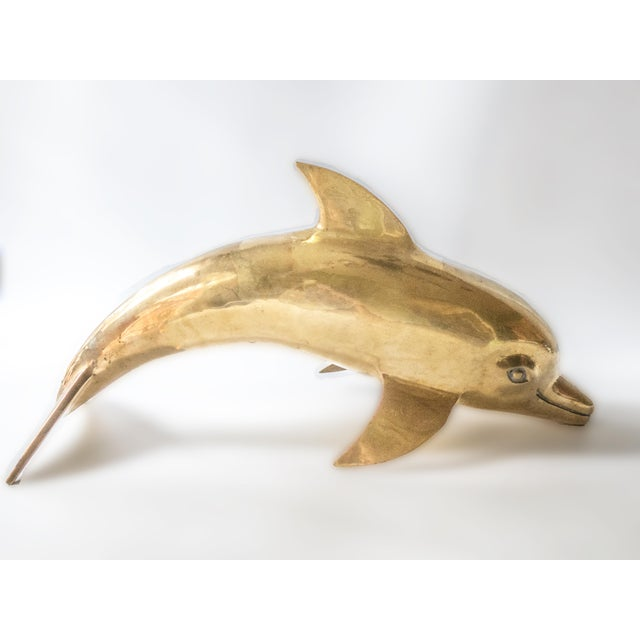 "Vintage 25"" brass, dolphin sculpture. This gorgeous piece of art is 7 1/2"" wide by 10"" tall and over 25"" long from tip of..."