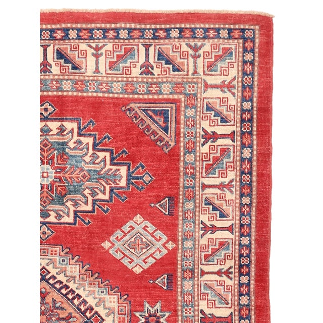 Kazak rugs are famed for their rich colors, assertive, geometric drawing and bold, and large-scale designs. The lustrous...