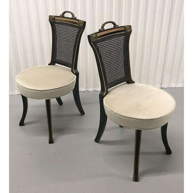 Handsome pair of Hollywood Regency accent chairs in Neoclassical style, circa 1960s. Cushions are newly upholstered in...