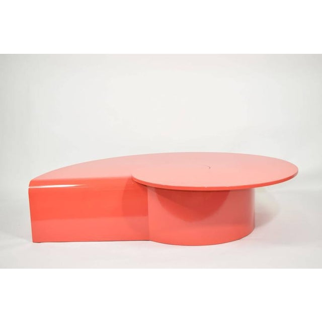 This is a custom coffee table with a swirl design. We have lacquered in a high-gloss red/orange.