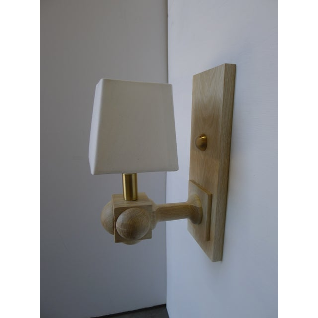 Paul Marra Foursquare Sconce. First four photos shown in bleached oak and satin brass. Also available in natural red oak...